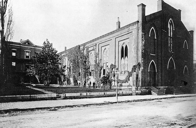 "The old St. Mary's Cathedral with the Bishop's residence at left, where the little girl presented him with the silver dollar and ""asked him to take it and build a new cathedral in Covington."" [Archives of the Diocese of Covington]"